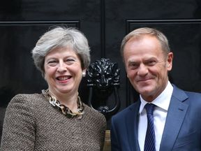 """File photo dated 26/9/2017 of Prime Minister Theresa May with President of the European Council Donald Tusk. May will reaffirm Britain's ongoing commitment to European security as she faces further pressure from EU leaders to spell out how she intends to settle the UK's Brexit """"divorce bill""""."""