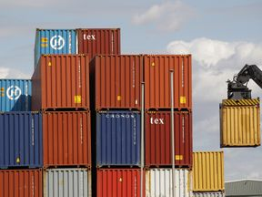 Containers are moved at Tilbury Docks, east of London
