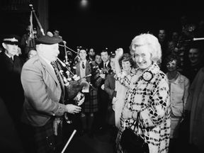 Winnie Ewing is greeted by supporters as she arrives in London to take up her seat in the House of Commons