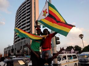 Zimbabweans celebrate the announcement in Harare