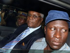 Former Zimbabwe finance minister Ignatius Chombo, arrives at court on to face corruption charges in Harare...