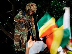 Crowds have been partying watched over by soldiers who helped end Mugabe's reign