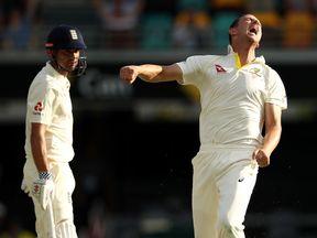 Josh Hazlewood of Australia celebrates after taking the wicket of Alastair Cook of England
