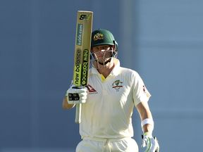 Steve Smith of Australia celebrates after reaching his half century  during day two of the First Ashes Test