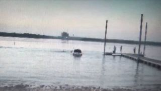 Man being chased by police drives into lake then tries to swim away