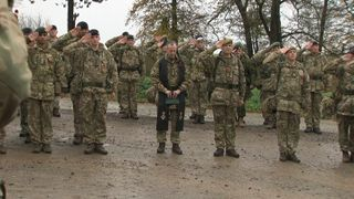Soliders hold a two-minute silence on Salisbury Plain