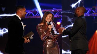 LEEDS, ENGLAND - NOVEMBER 29: Jay Sean (L) and viscountess Emma Weymouth present the Best African award to Davido on stage at the MOBO Awards at First Direct Arena Leeds on November 29, 2017 in Leeds, England. (Photo by Andrew Benge/Getty Images)