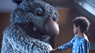 Moz the monster and seven-year-old Joe hope to lure in the shoppers for John Lewis this Xmas