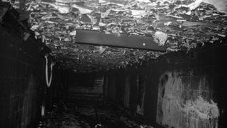 Melted roof tiles litter a subway tunnel after the fire at King's Cross Underground Station in London.