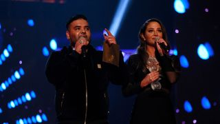 LEEDS, ENGLAND - NOVEMBER 29: Naughty Boy (L) and Tulisa Contostavlos speak on stage at the MOBO Awards at First Direct Arena Leeds on November 29, 2017 in Leeds, England. (Photo by Andrew Benge/Getty Images)