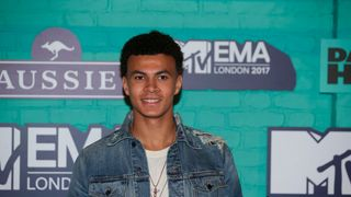 Tottenham Hotspur's English football player Dele Alli poses on the red carpet a