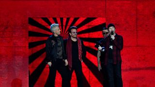 Irish rock band U2, Bono (2L), The Edge (R), Adam Clayton (L) and Larry Mullen Jr (2R), accept the global icon award