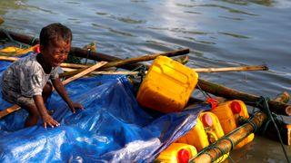 A Rohingya refugee boy cries after crossing the Bangladesh-Myanmar border