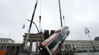 "Workers prepare the installation of the Art work ""Monument"" in front of the Brandenburg Gate in Berlin, Germany"