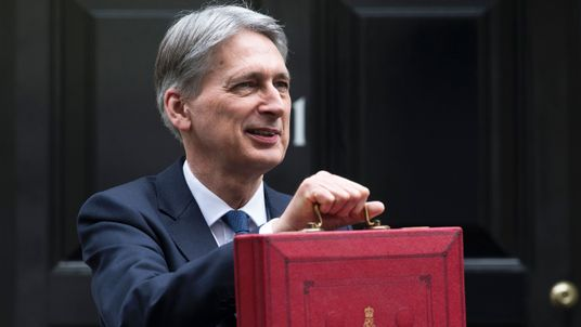 Philip Hammond poses for pictures with the Budget Box