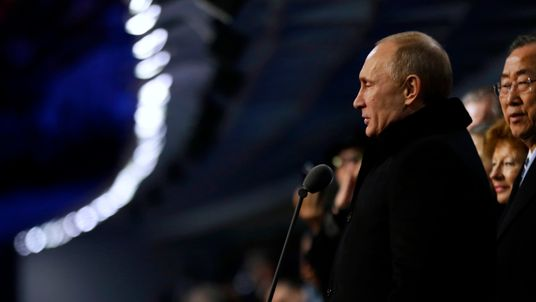 Russian President Vladimir Putin, right, declares the 2014 Winter Olympics open as United Nations Secretary-General Ban Ki-moon, right, looks on during the opening ceremony, Friday, Feb. 7, 2014, in Sochi, Russia. (AP Photo/David Goldman, Pool)