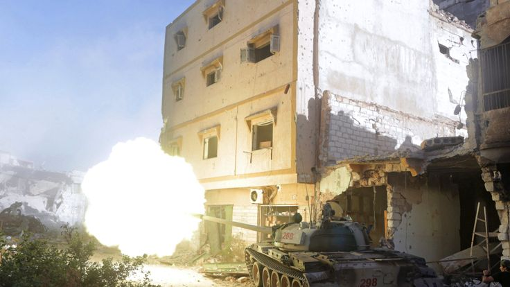 A Libyan National Army tank fires towards the positions of Islamist militants during clashes in Khreibish district in Benghazi, Libya