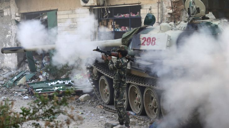 A member of the Libyan National Army fires a weapon during clashes with Islamist militants