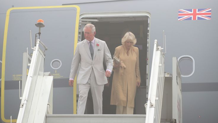 Prince Charles and Camilla, Duchess of Cornwall, arrive at New Delhi airport