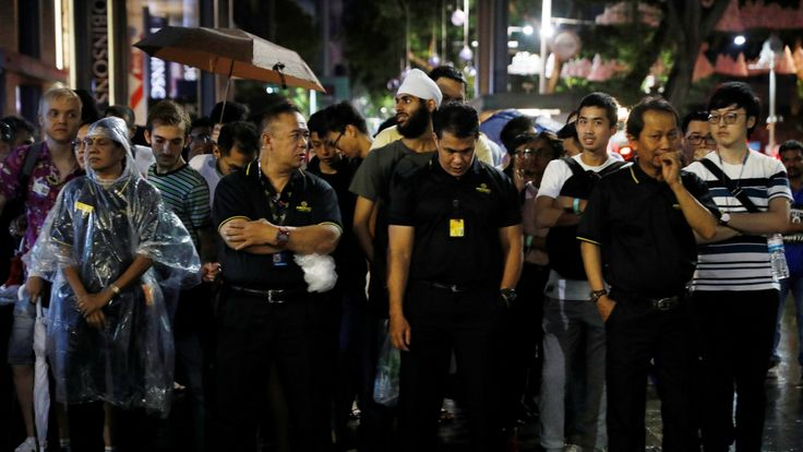 People queue overnight outside an Apple store in Singapore to get their hands on the device