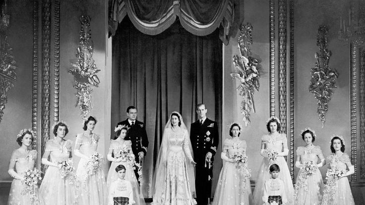 November 1947: Princess Elizabeth and the Duke of Edinburgh with their eight bridesmaids in the Throne Room at Buckingham Palace