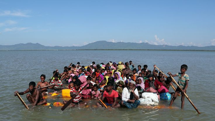 Rohingya refugees use a makeshift raft to reach Bangladesh