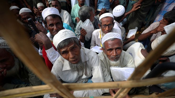 Rohingya refugees wait to received aid in Bangladesh