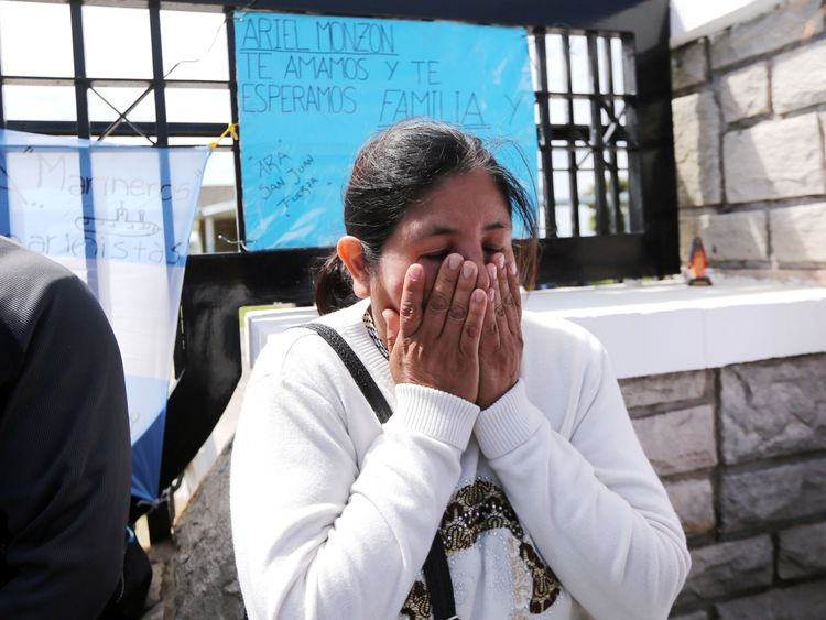 Apprehensive relatives of those missing are waiting at a naval base for news