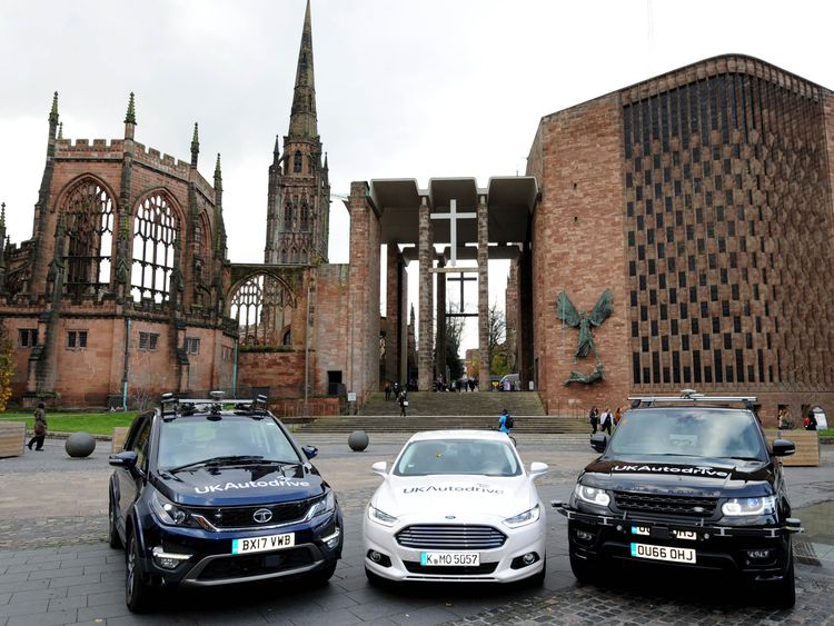The cars involved in the trial in front of Coventry Cathedral