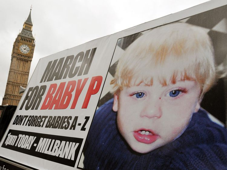 A poster on the back of a lorry precedes a group of campaigners, some with their children, as they march around London's Parliament Square in a protest for justice for Baby P, who died as a result of abuse in Haringey, north London, in August last year