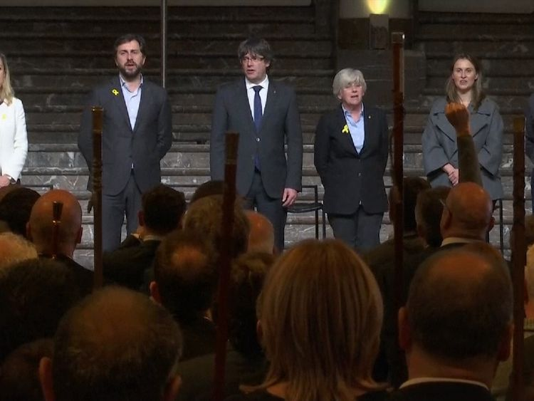 Mr Puigdemont and colleagues sang the Catalan national anthem