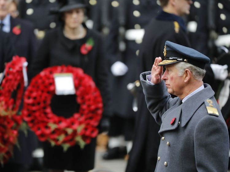 Prince Charles salutes in front of the Cenotaph