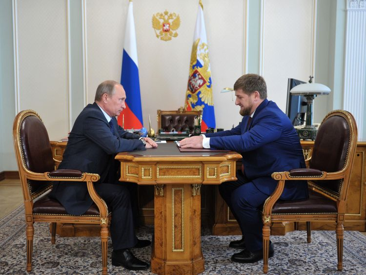 Mr Kadyrov with his 'idol', Vladimir Putin, in Russia in 2013