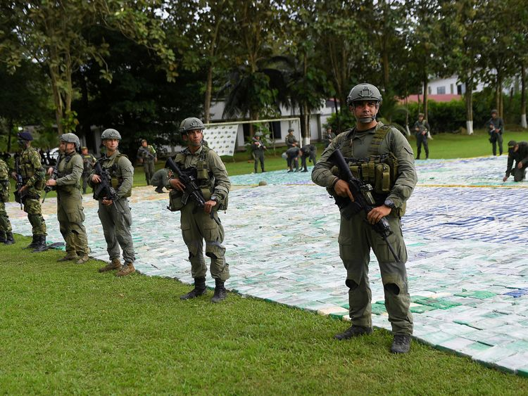 Dozens of heavily armed soldiers guarded the cocaine while it was put on display
