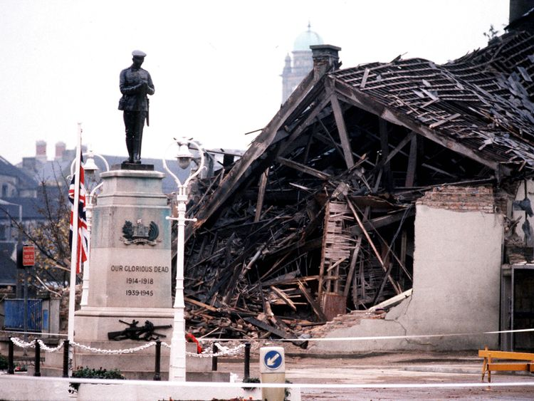 1987: The Cenotaph at Enniskillen with the devastated community centre in the background. 11 people died and more than 50 were injured in a massive IRA bomb explosion just before a Remembrance Day ceremony