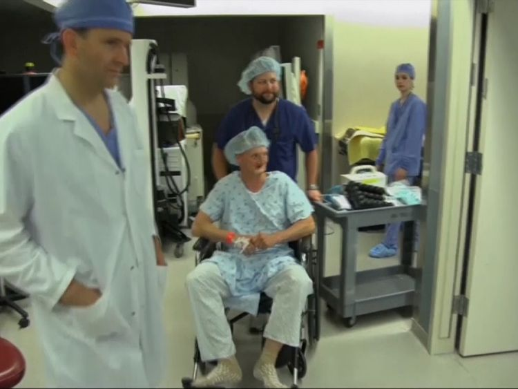 Andy Sandness is wheeled into surgery for his transplant