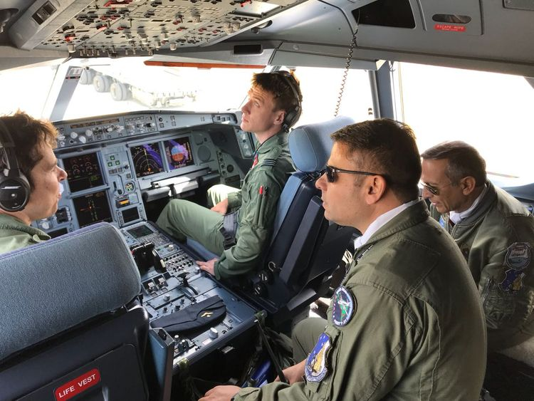 Argentine servicemen speak with RAF crew inside the cockpit of the plane. Pics: Guillermo Lobo