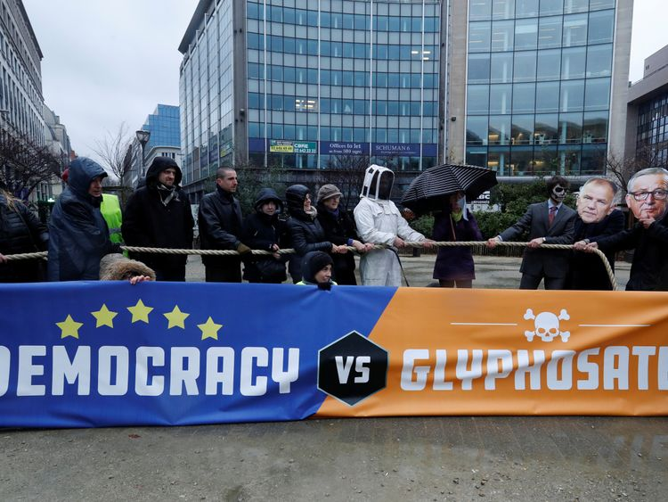Some protestors wore masks depicting EU Commissioner for Health and Food Safety Vytenis Andriukaitis European Commission President Jean Claude Juncker