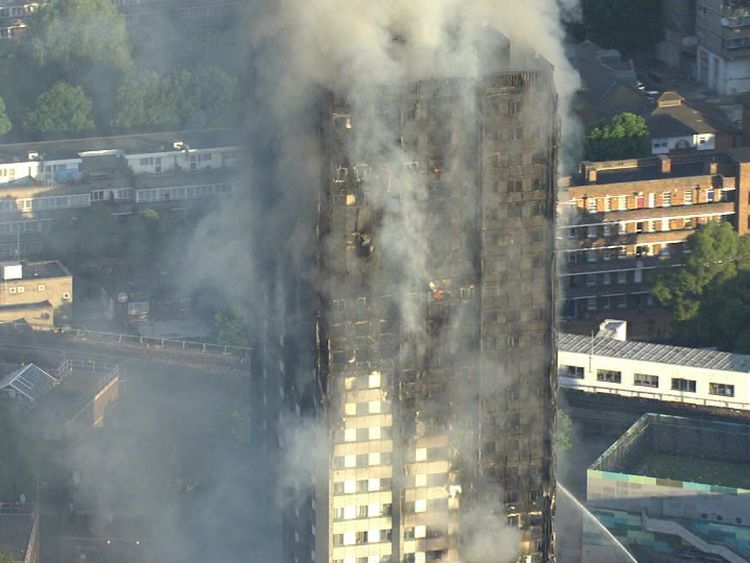 The smoking ruin of Grenfell Tower following the fire which killed71