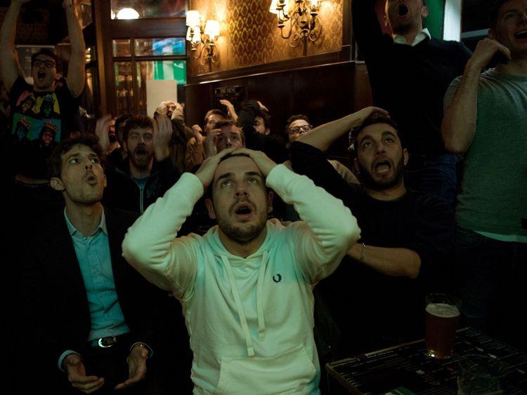Italian supporters show their despair as their team fail to qualify