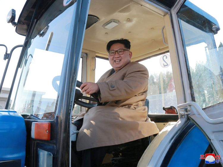 Kim Jong Un drove a tractor during his visit to a factory on November 14