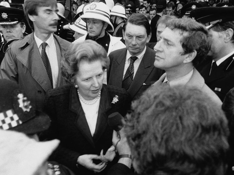 Prime Minister Margaret Thatcher and Transport Secretary Paul Channon (right) at the scene of the King's Cross Station fire