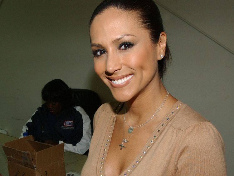 Leeann Tweeden signs an photo at Camp Arifjan, Kuwait, on December 12, 2006