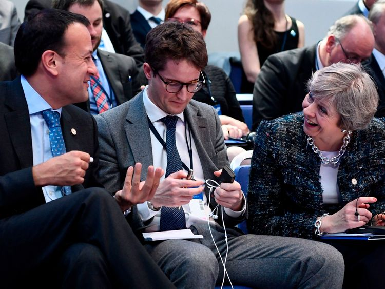 Ireland's Prime minister Leo Varadkar (L) and Britain's Prime minister Theresa May (R) talk ahead a discussion session during the European Social Summit in Gothenburg, Sweden
