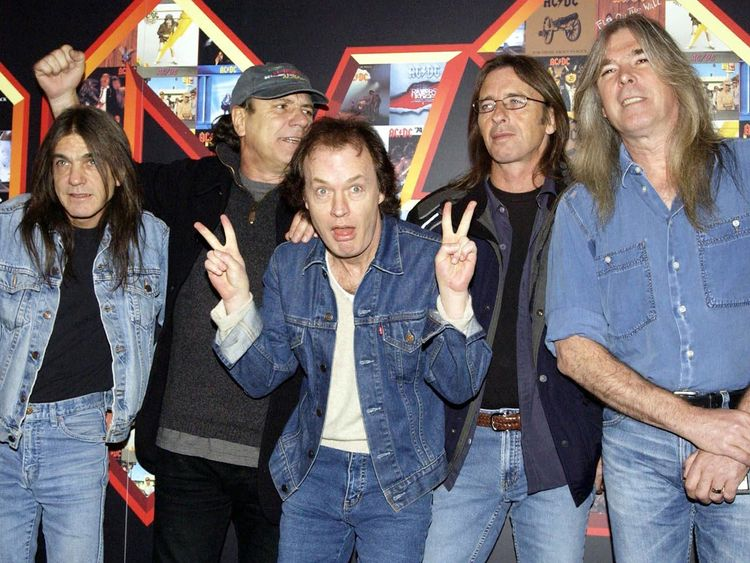 Young with the band in 2003. He retired 11 years later.