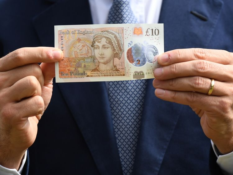The Governor of the Bank of England, Mark Carney, holds the new £10 note featuring Jane Austen, which marks the 200th anniversary of Austen's death, during the unveiling at Winchester Cathedral