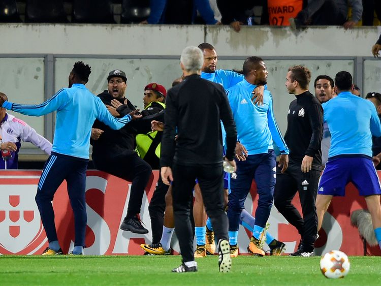 Evra is led away from the confrontation by a team-mate