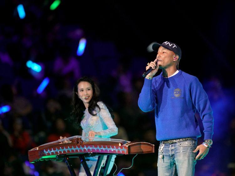 Pharrell Williams performs with Hong Kong singer Karen Mok