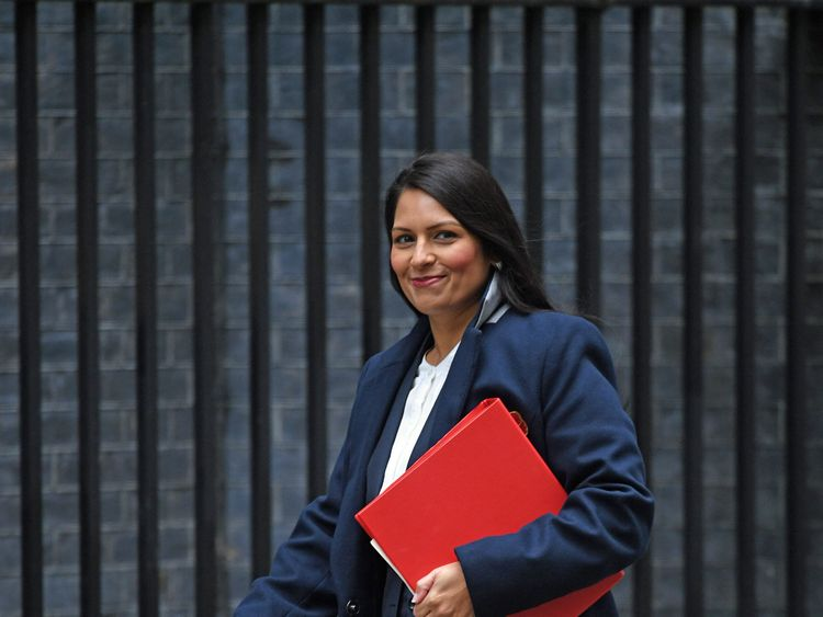 May under pressure to investigate Patel meetings