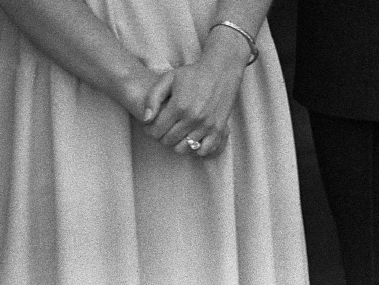 The Queen, then Princess Elizabeth, shows off her engagement ring at Buckingham Palace in July 1947